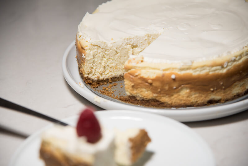 vanilla bean cheesecake walnut crust slice